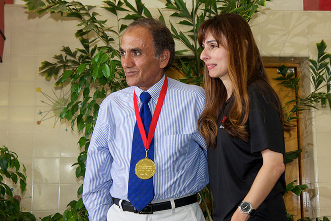 Ahmed Abou Harb receives his medal from President Sonya Christian