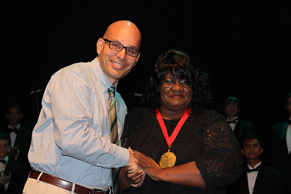 Mary Jane Johnson receives her 100 Stars of Bakersfield College medal from Emmanuel Mourtzanos