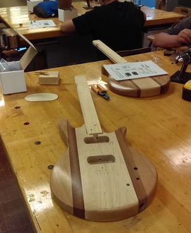 Guitar being built by students