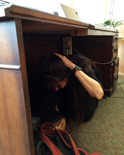 President Christian holding under a desk