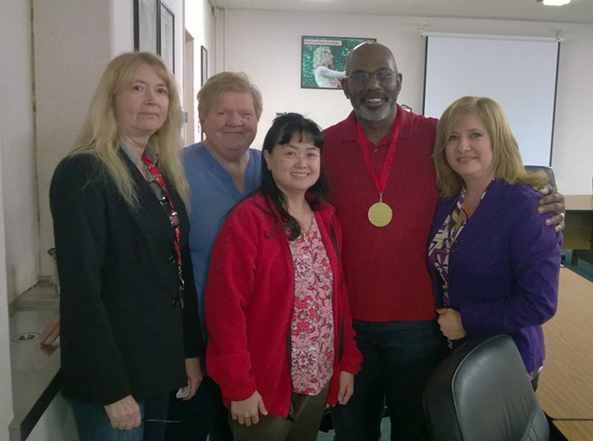 Jackie Fisher receives his 100 Stars of Bakersfield College medal