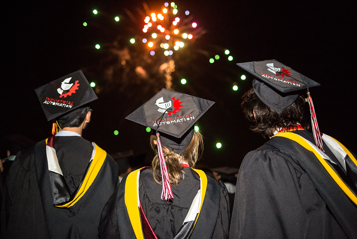Industrial Automation graduates watch fireworks at commencement