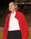 Smiling older woman wearing red jacket.