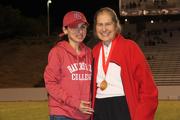 Jerry Ludeke receives her 100 Stars of Bakersfield College medallion from President Sonya Christian