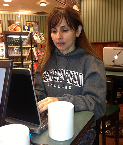 Sonya Christian works on her computer at Barnes & Noble