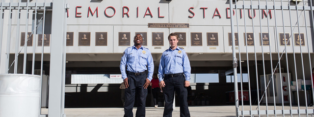 Two Public Safety Cadets stand outside Memorial Stadium