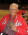 Elderly man wearing Renegade Jacket and medal.