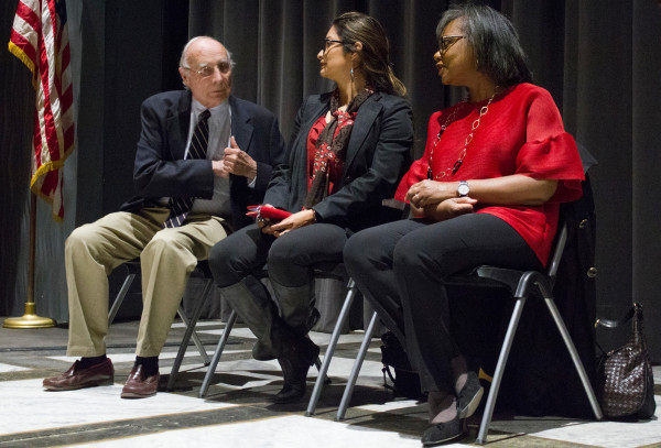 Jack Hernandez, Olivia Garcia and Anita Hill await the beginning of the lecture.