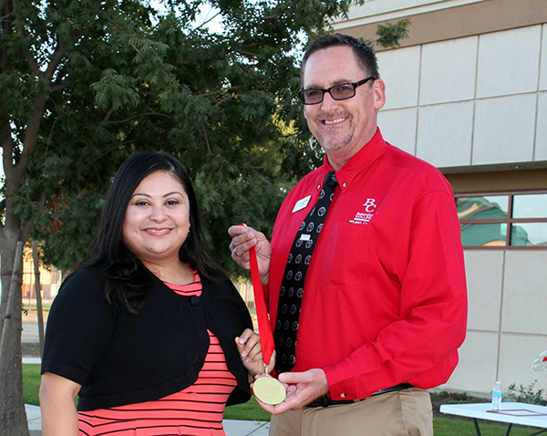 Irma Cervantes receives her 100 Stars of Bakersfield College medal