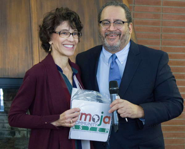 Dr. Michael Eric Dyson receiving a UMOJA t-shirt from Paula Parks.