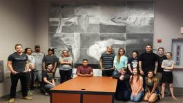 PHOTO CAPTION:  Students in Lisa Darty's Art C121 class at Cerro Coso Community College were asked to work both individually and as a group to complete a large scale drawing - a reproduction of the well-known surrealist work, The Persistence of Memory, by Salvador Dali.