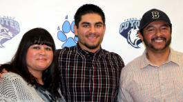 Signing Day for Hernandez: Biggie Hernandez (center) poses for a picture with Mom Natalie and Father Sergio during his signing on January 11th.