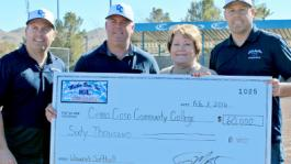Caption: Mather Brothers Inc. (l to r) Thomas Jr., Troy, Todd Mather present Cerro Coso president Jill Board with a check for $60,000 to reinstate Women's Softball.